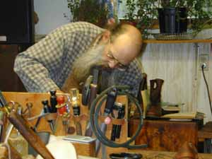 Lyle MacRostie, shoemaker, working in his shop